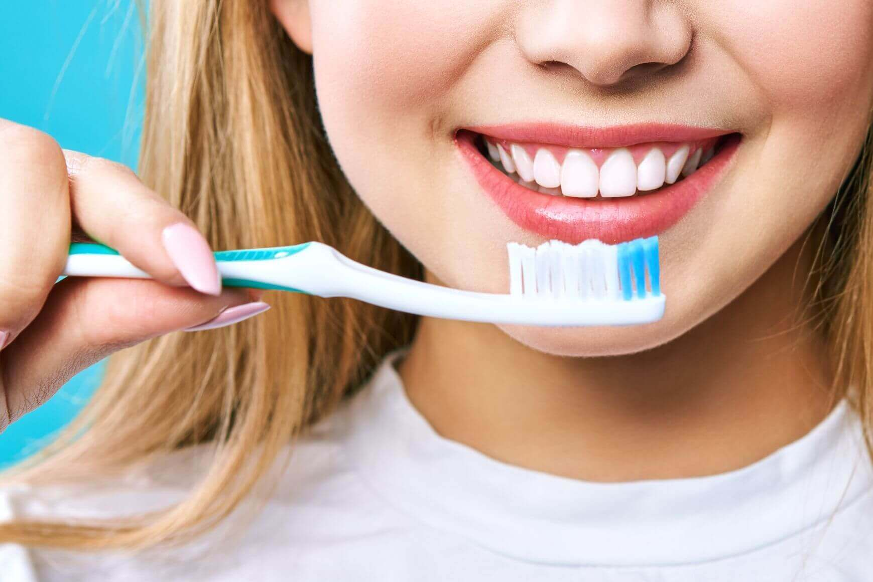 oung-beautiful-woman-is-engaged-cleaning-teeth-Your toothbrush can Transmit Corona virus